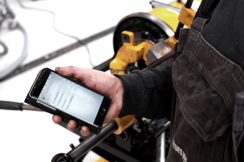 E-Komplets app på mobilskærm